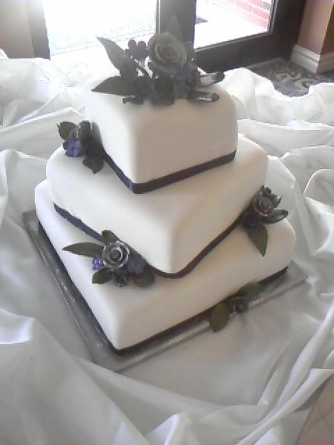 Ribbon navy wedding cake navy and silver cake