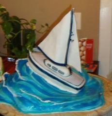 """boat cake"", ""wave cake"", ""beach cake"""